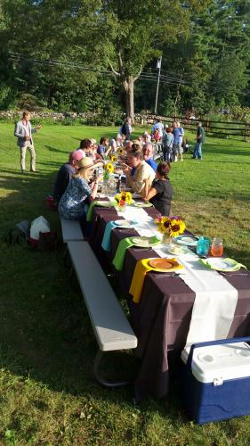 Dozens of visitors socialize and enjoy starters on Bethel's Holbrook Farm during the second of three farm dinners conducted this season. The final event will be at 5 pm on Sunday, October 15.