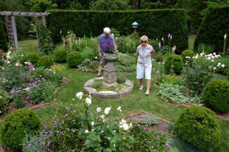 Frank Gardner and Chris Lincoln were among the guests who meandered through the meticulously maintained English Garden at the home of Lincoln and Jean Sander.