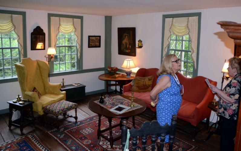 Jo-Ann Scebold and Carol Reilly Study the antiquities at the home of Lincoln and Jean Sander during to 2018 House & Garden Tour