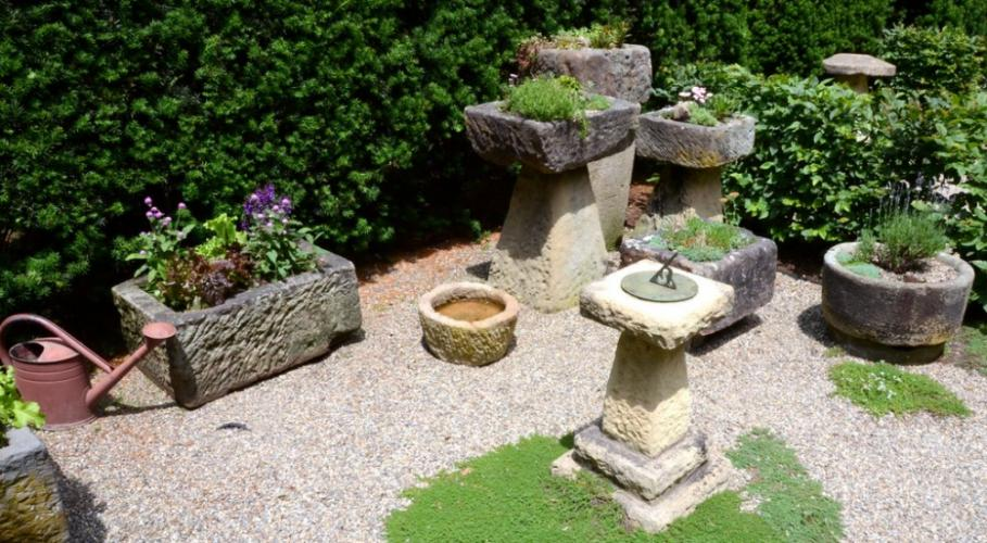 A rustic sundial serves as the focal point in the Sanders' trough garden.
