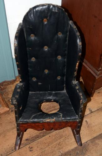 A leather-covered rocking potty chair was among the one-of-a-kind antiques that guests saw decorating the children's room at the home of Jean and Lincoln Sander, who hosted the 2018 Historical Society House & Garden Tour.