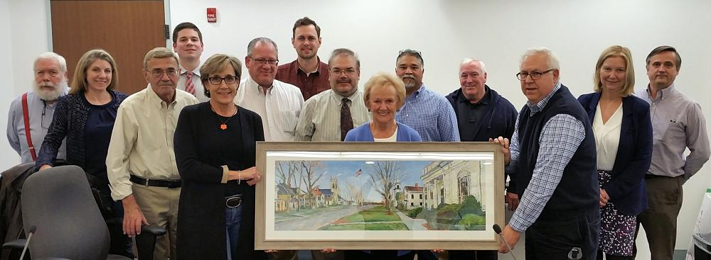 First Selectman Pat Llodra holds a Jim Chillington original presented to her on the occasion of her final meeting with the Legislative Council. The outgoing first selectman is surrounded by council members and staff after receiving the painting…