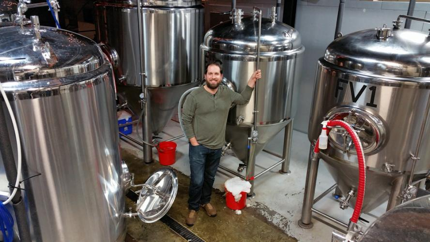 Nod Hill Brewery owner and Sandy Hook resident David Kaye stands among the ten brewing stations at his recently opened establishment and tap room in the Branchville section of Ridgefield.  (Bee Photos, Voket)