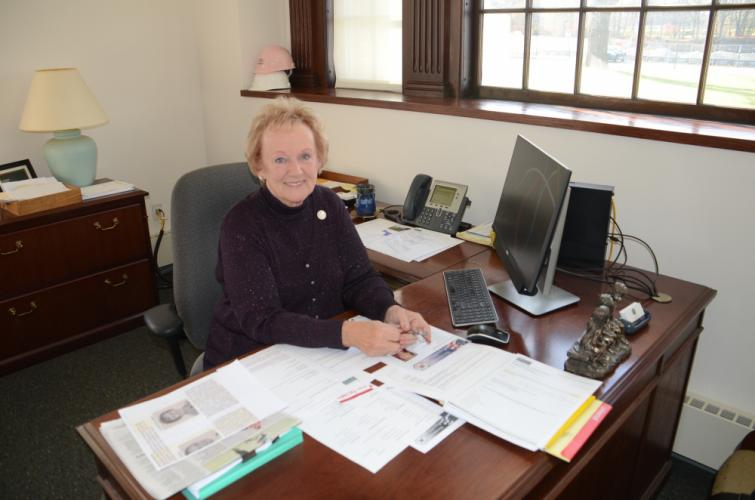 Days ahead of her departure after four terms of service as first selectman, Pat Llodra sits at her desk in the Municipal Center amid the remaining photos and mementos, many collected during her tenure as Newtown's top elected official.  (Bee Photo, Voket)