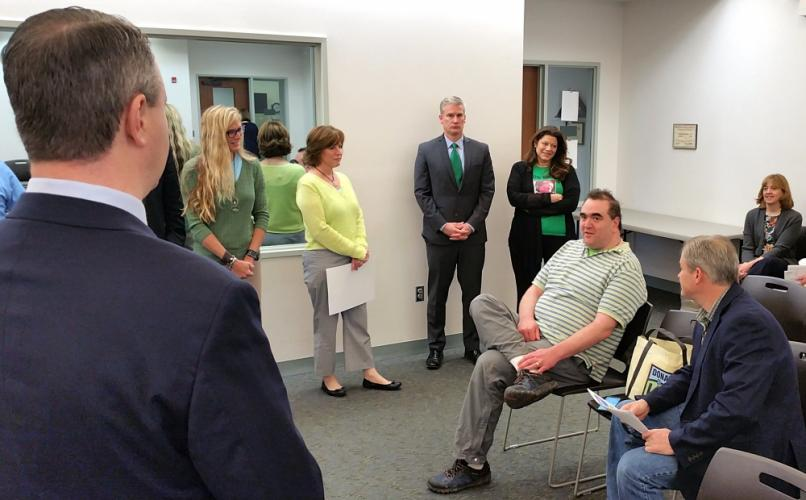 First Selectman Dan Rosenthal, in foreground, chats with town workers and Sandy Hook resident Daniel Krauss, who received a new heart from an organ donor in 2017. The group came together on April 13 - Blue & Green Day - to help encourage Americans…