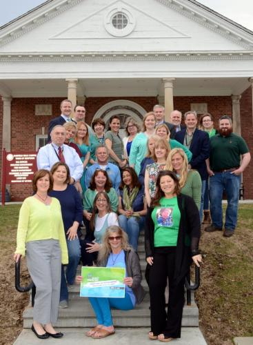 Newtown Building Department staff member Lynn Kovack, seated in front, is surrounded by her municipal and school district colleagues on Blue & Green Day April 13. She was joined by local organ recipient Daniel Krauss, top rear, second from left, who…
