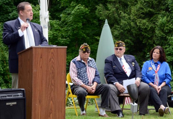 Newtown State Rep Mitch Bolinsky speaks during the Memorial Day ceremonies as Post 308 Commander Ray Wisniewski, Post Quartermaster Michael Mich, and Post Auxiliary member Jennifer Clark look on.
