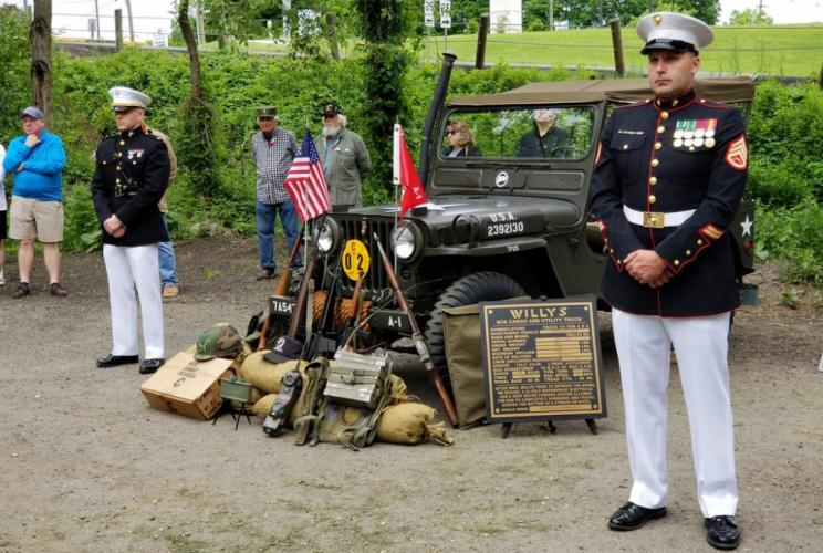 Marines Dustin Gill (left) and Zach Miller stationed themselves in front of an military Jeep and various memorabilia on display as part of Newtown's annual VFW Memorial Day ceremonies.