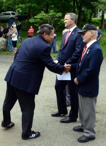 State Senator Tony Hwang greets former First Selectman Joe Borst and First Selectman Dan Rosenthal during Post 308 Memorial Day ceremonies May 28.