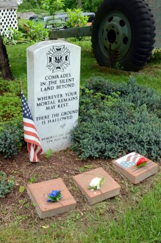 The 2018 Memorial Day ceremony at Newtown VFW Post 308 included the laying of a commemorative wreath by Commander Ray Wisniewski, and these red, white, and blue carnations on the Post's memorial marker by members of the Post Auxiliary. (Bee Photos, Voket)