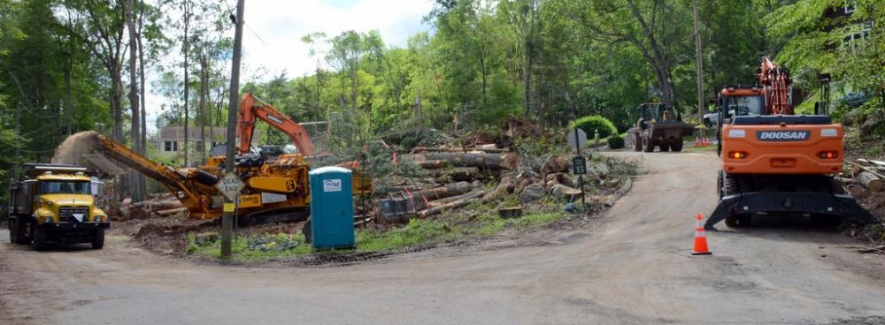Town crews and contractors from Total Landscaping & Tree Service are staging the bulk of log and storm debris processing for the hard-hit Cedarhurst lakeside community and adjacent neighborhoods at the intersection of Lakeview Terrace and Spring…
