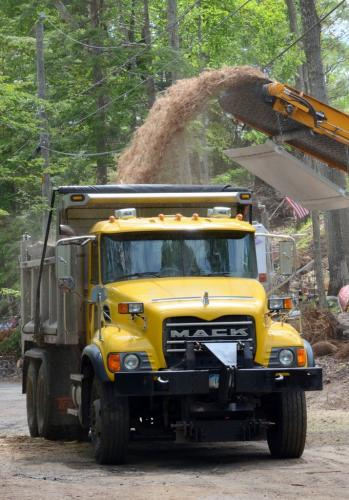 An industrial wood processor stationed at the intersection of Lakeview Terrace and Spring Trail reduced entire logs into a truck full of wood chips in a matter of minutes.  (Bee Photo, Voket)