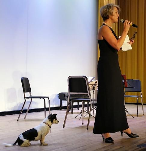 Kaia Fahrenholz, daughter of the late Newtown Friends of Music President Ellen Parella, served as MC for the organization's final concert October 15, along with her music loving four-legged companion, Touille.