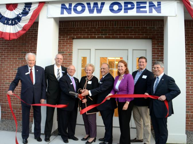 The new headquarters branch of Newtown Savings Bank held its official grand opening and ribbon cutting October 16 assisted by, from left, Newtown Chamber of Commerce President Brian Amy, branch manager Ryan Storms, Board of Directors Chairman John J…