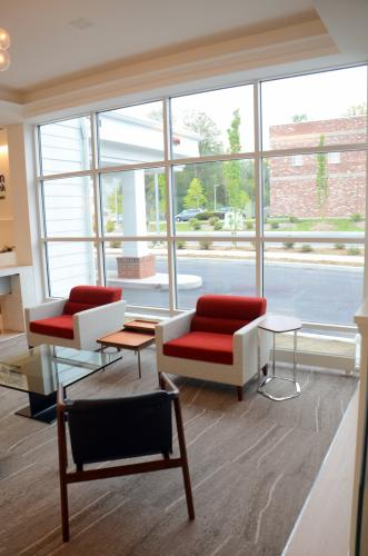 Huge windows promote both security and natural light for customers waiting to speak with Newtown Savings Bank retail, investment, or mortgage associates at the new branch.