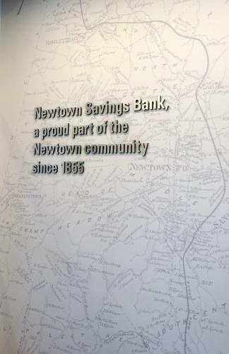 A replica of a circa 1860s Newtown map welcomes customers at the main entrance of Newtown Savings Bank's new retail headquarters at 32 Church Hill Road, also reminding visitors of the financial institution's longevity serving the local community and…