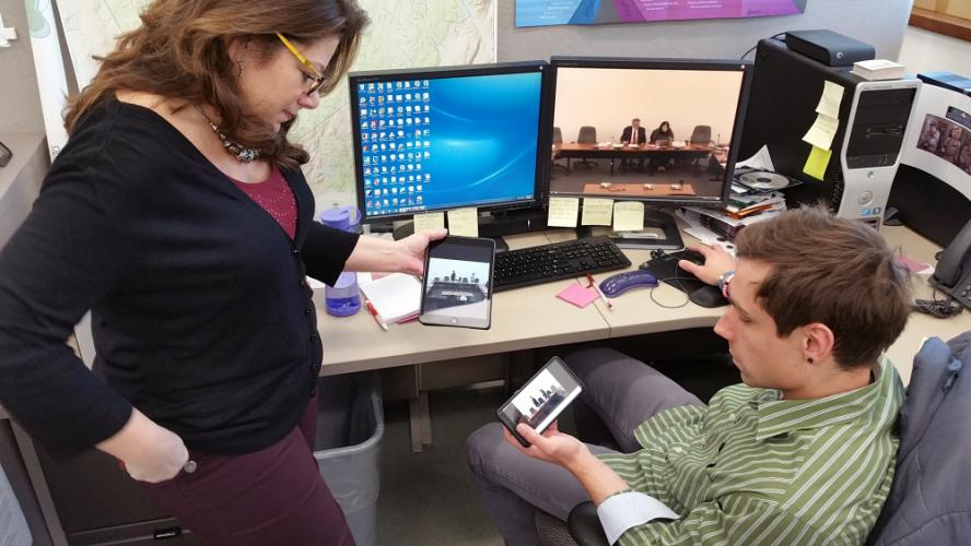 Town Clerk Debbie Halstead and Town GIS Specialist Kevin Dunkin view an archived Board of Finance meeting from the municipal website using a desktop computer, tablet, and smart phone March 5 in the local IT Department offices. The current viewing…