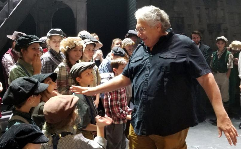Harvey Fierstein, high-fives members of the NewArts cast of Newsies on August 1. The Tony winning writer, actor and voice talent sat in on part of a rehearsal for the production that will close this weekend at Masuk High School in Monroe.