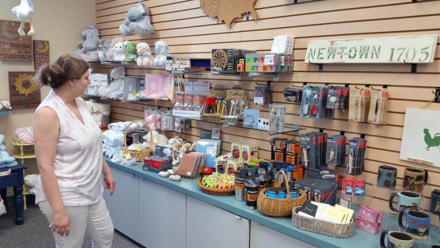 The Gift Box owner Martine Shanchuk looks over the line of men's specialty products and gifts she is currently stocking at her newly opened gift store on the corner of Queen Street at 14 Church Hill Road.