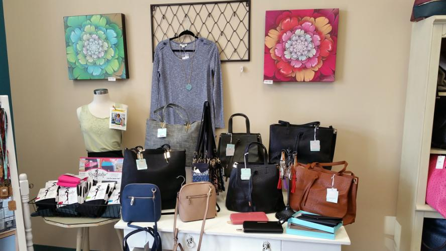 Along with a limited line of Shihreen ponchos and cardigans, The Gift Box is stocking a selection of sharp Katie Q brand purses and wallets, which owner Martine Shanchuk was drawn to because of their nice fall colors, styles, and durable materials.