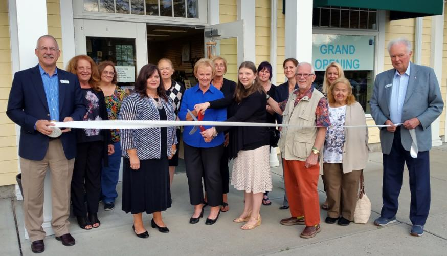 Owner Martine Shanchuk is joined by First Selectman Pat Llodra, family members, store associates, and representatives from the Newtown Chamber of Commerce and Economic Development Commission during ribbon cutting festivities to open The Gift Box at…
