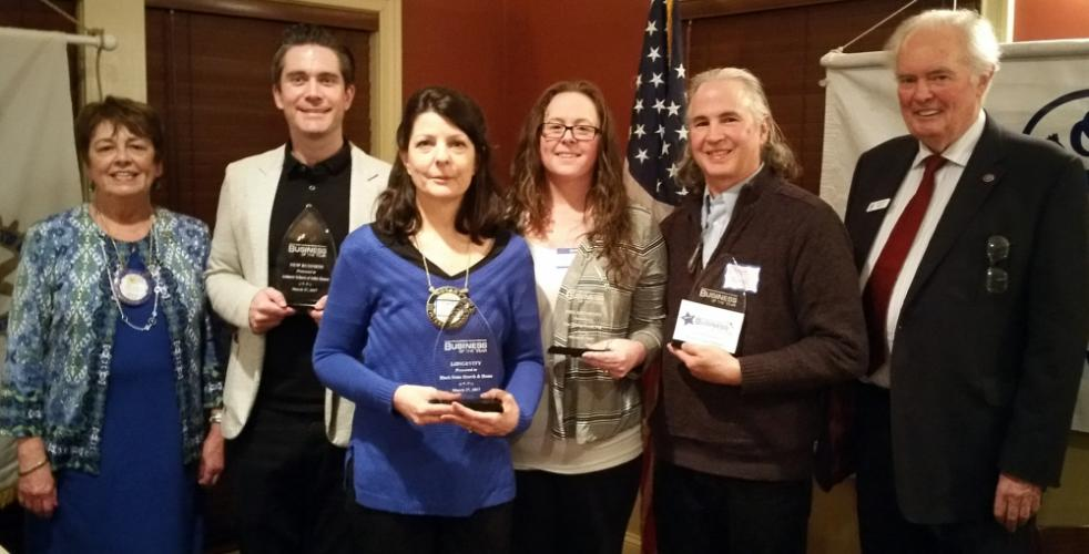 Newtown Rotary President Mary Griffin, far left, and Newtown Chamber President Brian Amey flank the 2017 Business of the Year winners, Craig Ashurst of Ashurst Academy of Irish Dance, Carrie Swan of Black Swan Fireside Hearth & Home, Abby Hill of…