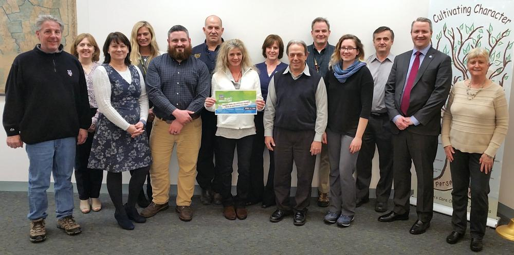 First Selectman Dan Rosenthal, second from right, joins his Executive Assistant Susan Marcinek, center rear, and a number of other town and school district staffers reminding residents that April is Donate Life Month. She is encouraging all town and…