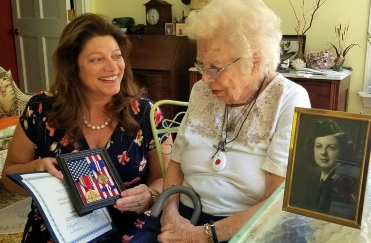 Town Clerk Debbie Halstead delivers a set of Connecticut Wartime Service Medals, a service ribbon, and a certificate recognizing Dorothea LaBelle, a long-time Newtown resident, on June 29. The certificate is signed by the governor and commissioner…