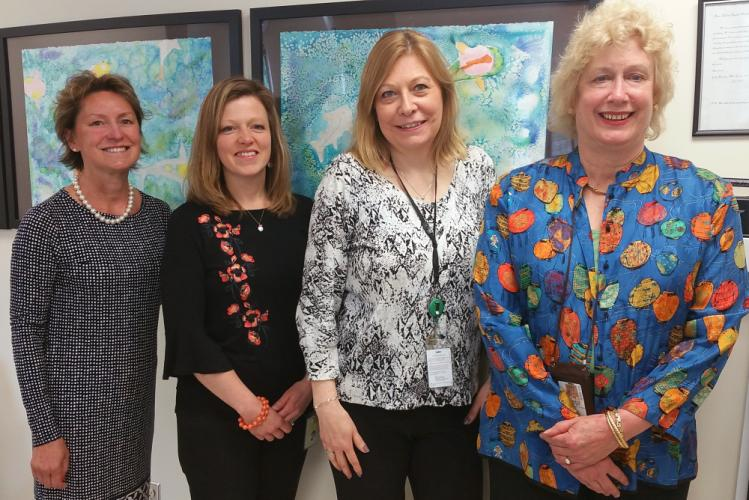 Newtown Middle School's School-Based Health Center manager Melanie Bonjour is joined by clinician Nicole Woering, MSN NP-C APRN, office manager Nancy Kettner, and Jennifew Sawyer, LCSW, during an interview looking back on the clinic's two years of…