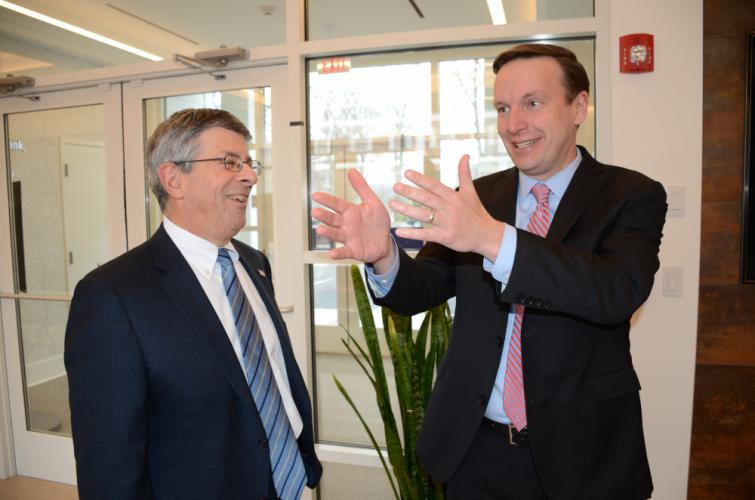 US Senator Chris Murphy, right, jokes with Newtown Savings Bank CEO Ken Weinstein during a brief tour of a number of businesses March 28 at the Village at Lexington Gardens on Church Hill Road.