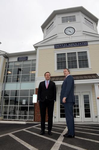Looking over one of Newtown newest retail locations, US Senator Chris Murphy, left, and First Selectman Dan Rosenthal prepare to tour the new Dental Associates offices in the Village at Lexington Gardens.