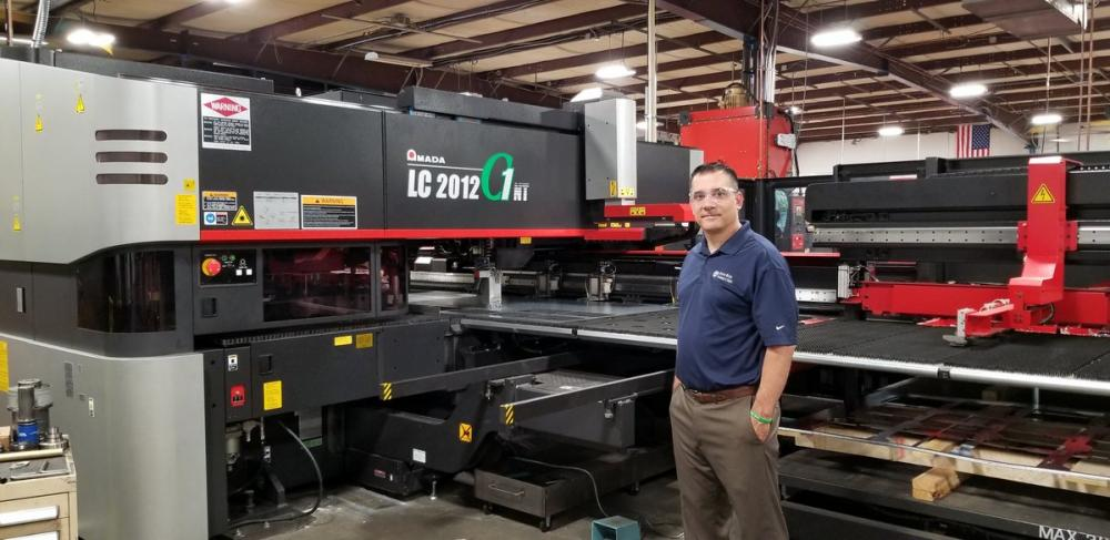 Third generation CEO Rodd Blessey stands by one of the massive advanced manufacturing machines on the shop floor at Aldine Metal Products. The company, founded by his grandfather Robert Blessy, is celebrating its 80th year in business.