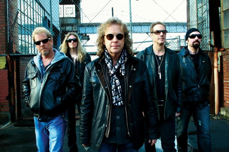 Bassist and singer Jack Blades, center, along with his Night Ranger colleagues, from left, Brad Gillis (lead & rhythm guitars), Keri Kelli (lead & rhythm guitars), Kelly Keagy (drums, vocals), and Eric Levy (keyboards) are guaranteeing a concert…