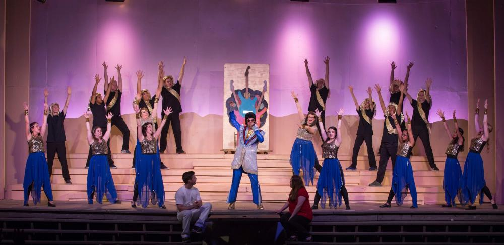Pharaoh (Robert Bria of Redding, center) tells Joseph of his big dreams in <i>Joseph and the Amazing Technicolor Dreamcoat,</i> in production for two more weekends at Danbury's Musicals at Richter.  (David Henningsen Photography photo)