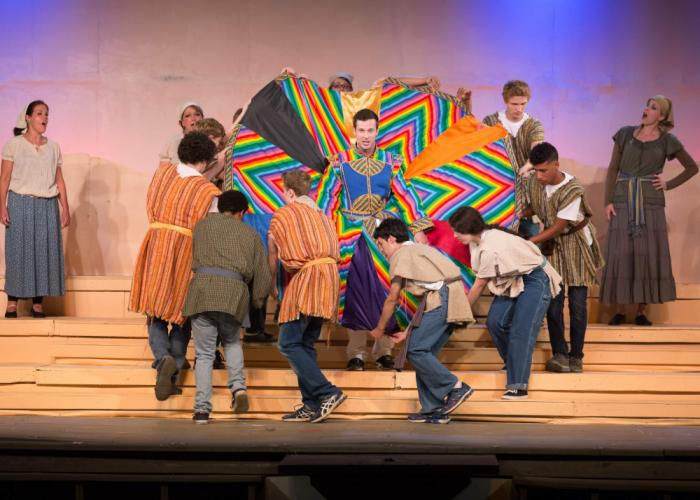 Joseph (Connor Spain of Bethel) models his new coat of many colors in <i>Joseph and the Amazing Technicolor Dreamcoat,</i> the popular family-friendly Tim Rice/Andrew Lloyd Webber musical playing at Danbury's Musicals at Richter through August 6.  …