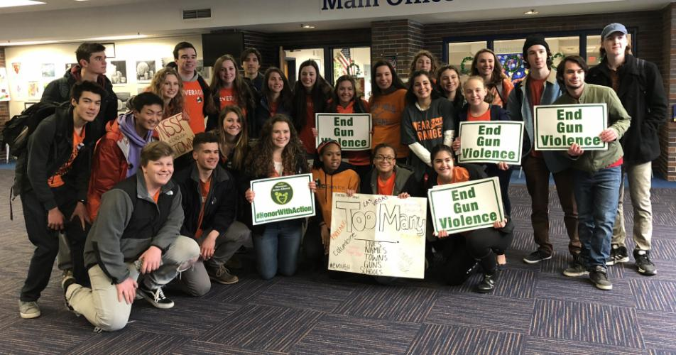 Jr NAA members gather for a photo in the main lobby at NHS on March 14, just after the day's planned walkout.