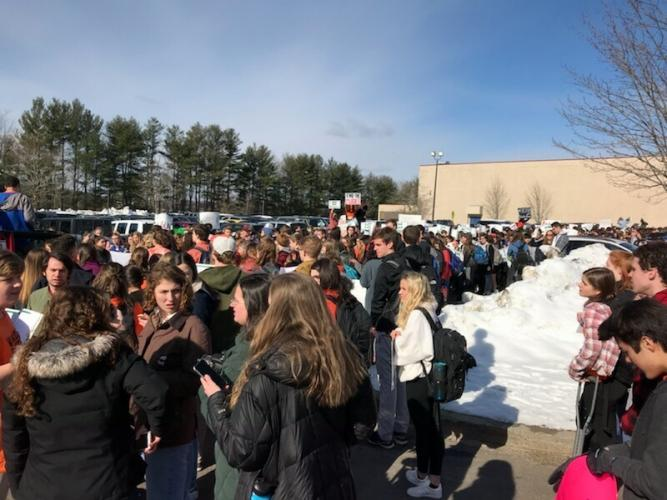 NHS students gather in the school's parking lot during the March 14 walkout. (Janice Gabriel photo)