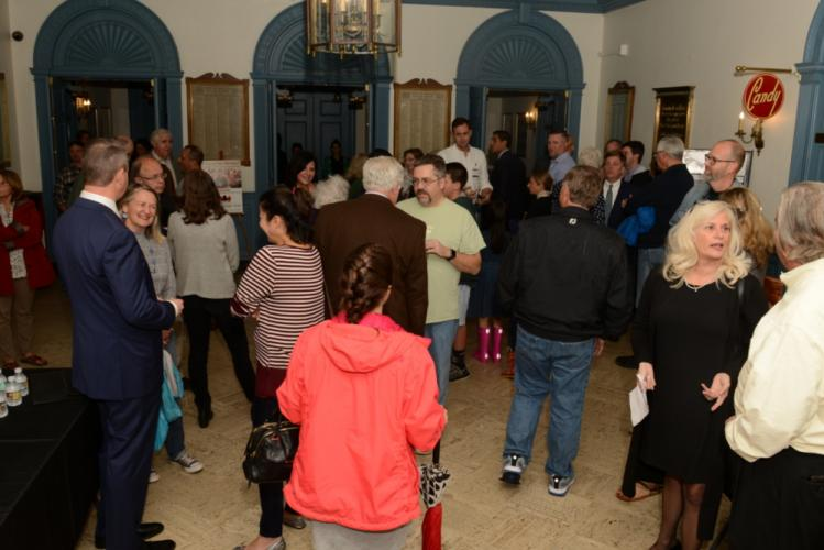 Prior to the start of the Candidates' Forum on Tuesday, residents mingled with first selectman and selectman candidates in the lobby of Edmond Town Hall.  (Bee Photo, Bobowick)