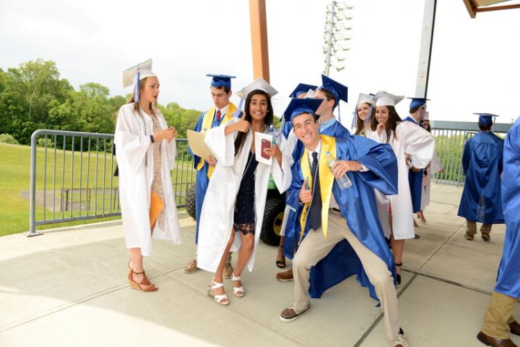 Newtown High School Valedictorian Simran Chand and Senior Class Officer Dylan Lew took a second to be a little goofy with friends at the NHS graduation ceremony at Western Connecticut State University's O'Neill Center on June 13. (Bee file photo)