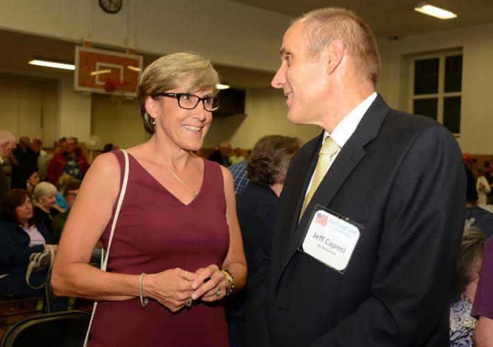 Aspiring Republican First Selectman candidate Mary Ann Jacob, and Republican Town Committee Chairman and Board of Selectman candidate Jeff Capeci chat as a packed GOP caucus winds down in the gym at Edmond Town Hall July 24.  (Bee Photo, Bobowick)