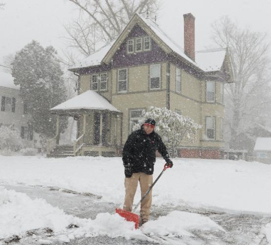 At the height of the storm Wednesday, John Madzula got a jump on shoveling as he clears the walkway in front of his Main Street home.  (Bee Photo, Bobowick)