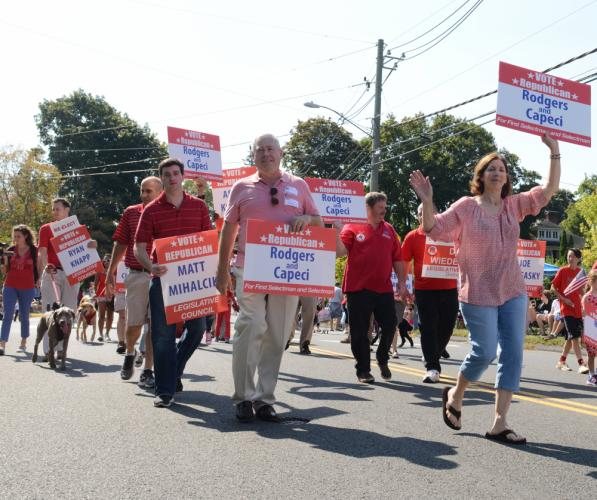 First Selectman candidate Will Rodgers and his team held signs while walking in the Labor Day Parade. (Bee Photo, Bobowick)