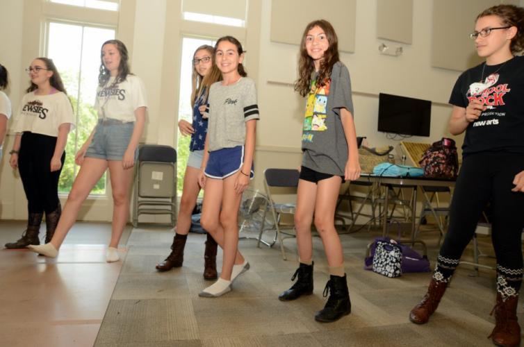 NewArts 'Newsies' dancers, from left, Nicole Kolitsas, Sophia Soriano, Reese Wheat, Ava Baroody, Sophia Baroody, and Rebecca Markowsky go through their moves during a July 11 rehearsal at Newtown Congregational Church.