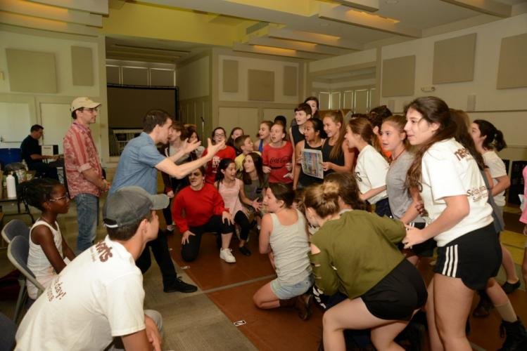 Chaz Wolcott works with the NewArts cast of 'Newsies' July 11 in the Great Room at the Newtown Congregational Church.