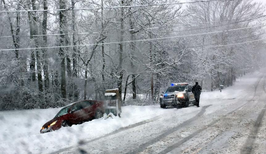 Driving midafternoon was risky as snow began covering roads Wednesday. One driver on Berkshire Road, near its intersection with Great Ring Road, appears to have slid into a front yard. The Ford was later towed.  (Bee Photo, Bobowick)