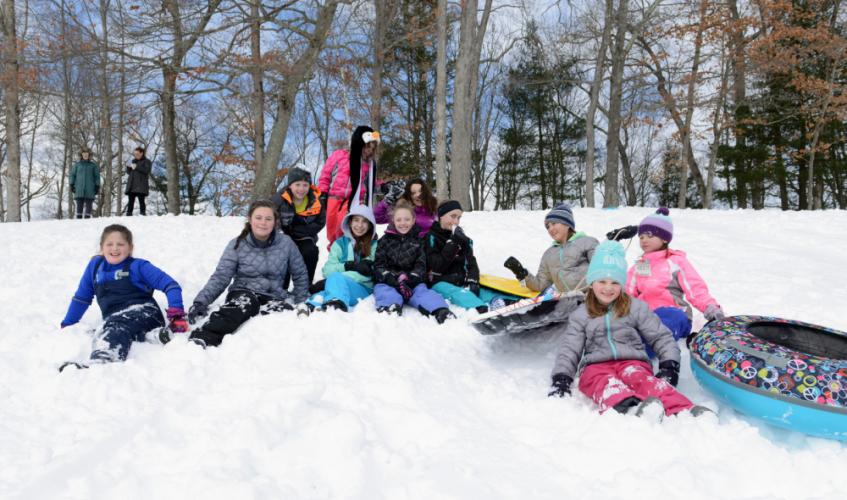 Pausing briefly Wednesday in their slippery trips down Treadwell Park's hill and the relentless march back to the top are friends from Hawley, Reed and Middle Gate schools. From left are Gabrielle Ansman, Sarah Guion, Stephen Singlak, Mary Guion …