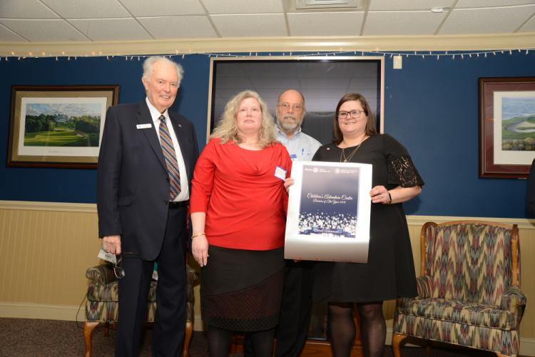 Janice Butler, center, and Karissa Peters, right represent the Children's Adventure Center, which won the Overall Achievement award. Presenting the award are Chamber of Commerce President Brian Amey, left, and Rotary President Joe Hemingway.