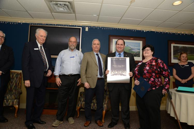 Brian Amey Newtown Chamber of Commerce president, Rotary President Joe Hemingway, and member Steve Samson present the award for Philanthropy to Brian Fonck of Newtown Savings Bank, with Marie Schlump, Café Xpresso, right.