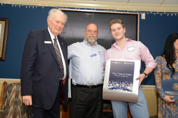 Chamber of Commerce President Brian Amey and Rotary President Joe Hemingway present the New Business award to Nick Heron from Nick's Chilled & Distilled.