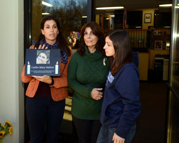 Resiliency Center of Newtown founder and Director Stephanie Cinque, left, holds a plaque in memory of volunteer Caitlin Nelson. With her is Caitlin's mother, Roseann Nelson, and sister, Anne Vetri.--Bee Photo, Bobowick